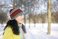 Woman in Snow. Beautiful brunetka winter on the street looks into the distance and laughs Stock Photography