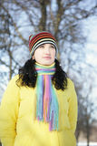 Woman in Snow. Beautiful brunetka winter on the street looks into the distance and laughs Stock Images