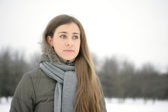 Woman in Snow. Beautiful brunetka winter on the street looks into the distance Royalty Free Stock Photos