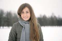 Woman in Snow. Beautiful brunetka winter on the street laughs Stock Photo
