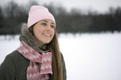 Woman in Snow. Beautiful girl winter on the street looks into the distance and laughs Stock Images
