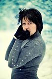 The woman and snow Royalty Free Stock Photos