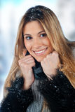 Woman in snow. Attractive woman in winter clothes covered with snow Royalty Free Stock Photo