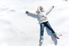 Woman on snow Stock Photos