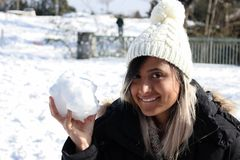 Woman with a snow ball. Having fun. Winter clothes. royalty free stock images