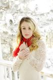 Woman in snow. Beautiful blonde woman stands in snow Royalty Free Stock Image