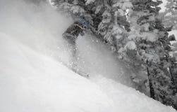Woman snow boarder #5 in action. Woman snowboarder enjoys fresh powder at snowbird ski and summer resort #5 Stock Image