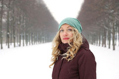Woman in snow covered alley Royalty Free Stock Images
