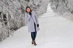 Woman on snow covered road Royalty Free Stock Image