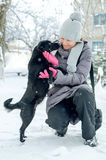 Woman snow dog Royalty Free Stock Images