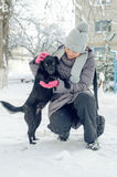 Woman snow dog Royalty Free Stock Photo