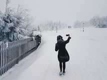 Woman in Snow Field Stock Images