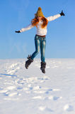 Woman on the snow field Royalty Free Stock Image