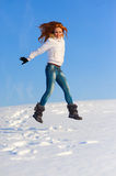 Woman on the snow field Royalty Free Stock Photography