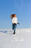 Woman on the snow field Stock Image
