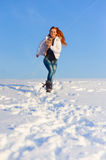 Woman on the snow field Royalty Free Stock Images