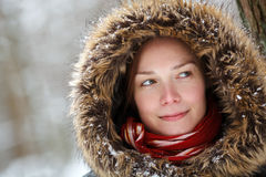 Woman in snow forest with neck piece and red scarf smiling. Woman in snow winter forest with neckpiece and red scarf smiling Stock Image