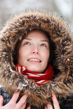 Woman in snow forest with neckpiece and red scarf smiling. Woman in snow winter forest with neckpiece and red scarf smiling Stock Photos