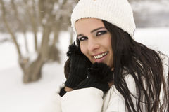 Woman in snow with hands on face Royalty Free Stock Photography