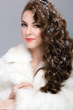 Woman with snow in her hair Royalty Free Stock Photos