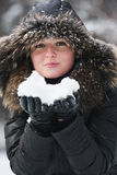 Woman with snow lump Stock Photo