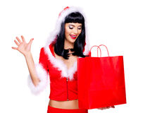 Woman in snow maiden suit holds the shopping bags Stock Photography