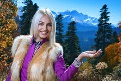 Woman in snow mountain Royalty Free Stock Photos