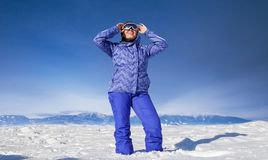 Woman in snow mountain Royalty Free Stock Photography