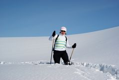 Woman on a snow path Stock Photography