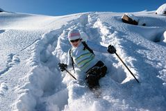 Woman on a snow path in mountains Royalty Free Stock Image