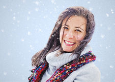 Woman in snow. Pretty woman in a snow shower portrait Royalty Free Stock Photo