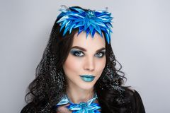 Woman snow queen. Young beautiful bright showy girl lady model snow queen. Fairy tale future party disco club. new Art makeup flawless face blue accessory, brown Royalty Free Stock Image