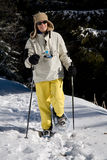 Woman snow shoeing Royalty Free Stock Photo