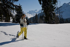 Woman snow shoeing in the mountains Royalty Free Stock Photos