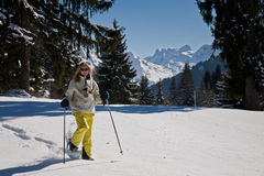 Woman snow shoeing in the mountains Stock Image