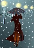 Woman and snow. Snowfall. A woman under an umbrella. Firs in the light of lanterns Stock Photos
