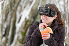Woman in snow with virtual reality glasses Stock Photography