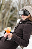Woman in snow with vr glasses Royalty Free Stock Image