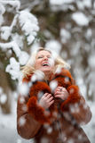 Woman in snow winter forest. Pretty young Woman in snow winter forest close eyes royalty free stock photography