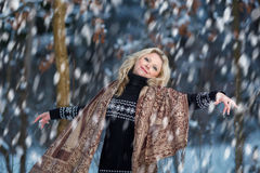 Woman in snow winter forest. Pretty dancing young Woman in snow winter forest Stock Photo