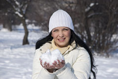 Woman with snow in a winter sunny day Stock Photo
