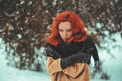 Woman and snow Royalty Free Stock Image