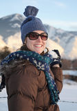 Woman with snowball Stock Image