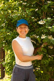 Woman with    snowball tree Stock Images