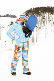 Woman with snowboard Stock Image