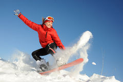 Woman on snowboard Stock Images