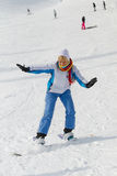 Woman with snowboard. Young laughing woman with snowboard on the snow Stock Photography
