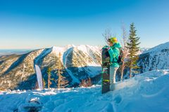 Woman with snowboard freerider on the mountain sunrise Stock Images