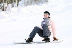 Woman on snowboard Royalty Free Stock Photos