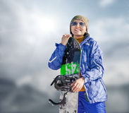Woman with snowboard on the sky background Royalty Free Stock Photo